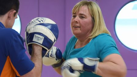 Karen Fulcher exercises by boxing with her personal trainer, Dan Andrews, at the Riverside Leisure C