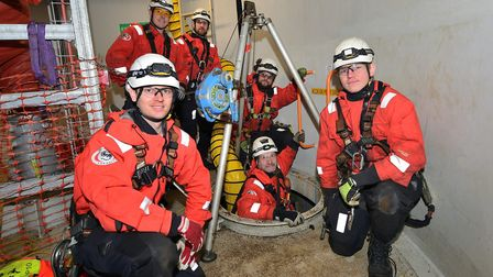 CHPV's Alan O'Neill, in the hatch, with the 3Sun's confined space rescue team and SSE's access team.