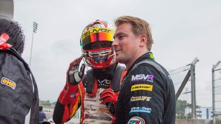 Tom Ashton speaking to team-mate Billy Lo at the China GT Championship. Picture: Submitted