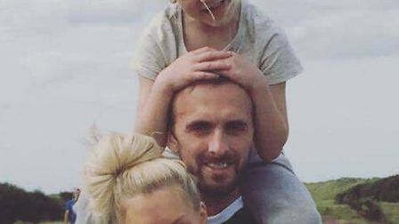 A charity football match is to be held in memory of Scott Hanks. He is seen here with his wife Amber