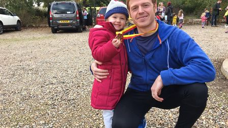 Mark Armstrong with daughter, Lara, after completing the Trowse 10k on Sunday. Picture: Alison Armst