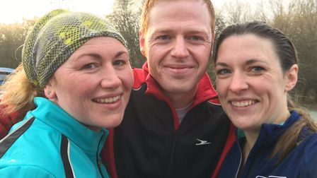 Mark Armstrong with sister, Karen, left, and wife, Alison after a parkrun. Picture: Mark Armstrong