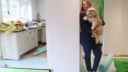 It's a dilemma...Dorothy Thompson and her dog Rupert with the imposing pillar