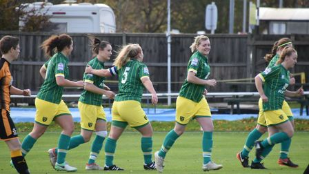 Norwich City Ladies' Chelsea Garrett is congratulated for her goal by captain Grace Parker. Picture: