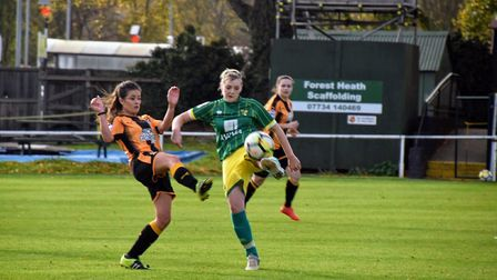 Norwich City Ladies' Natasha Snelling is first to the ball against Cambridge. Picture: Brian Coombes