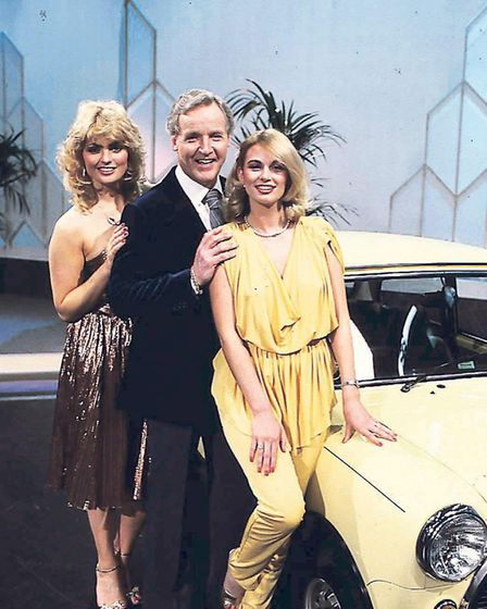 Nicholas Parsons with the show hostesses on Sale of the Century