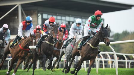 Action from the fourth race of the day at Fakenham Racecourse. Picture: Ian Burt