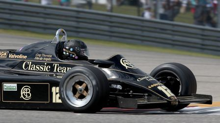 Winner of the first Circuit of Americas race Greg Thornton in his Lotus 91 tended by Classic Team Lo