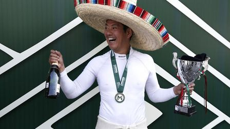 Lotus 78 racer Katsuaki Kubota celebrating on the top step of the podium a double victory in Mexico.