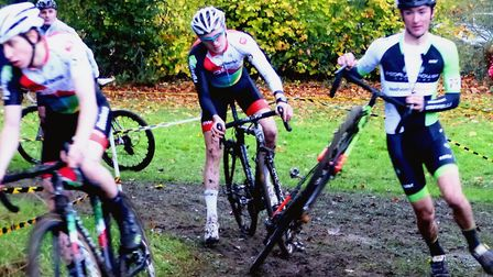 Dougal Toms runs into the lead, passing James Madgwick (left) and Sean Dunlea, at West Suffolk Wheel