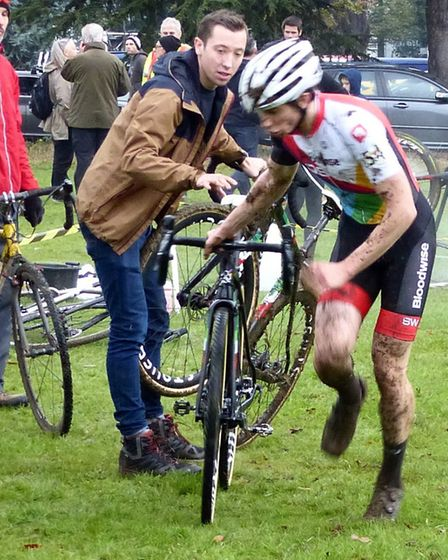 UEA's Matthew Madgwick (left) hands a clean bike to twin brother James at West Suffolk Wheelers cycl