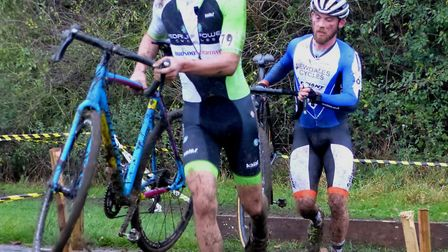 Swainsthorpe rider Dougal Toms leads Callum Riley over the planks at West Suffolk Wheelers cyclo-cro