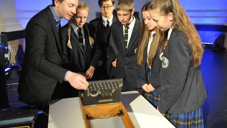 Students from Benjamin Britten High School, in Lowestoft, look at an Enigma machine from the Second