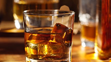 Close-up photo of a glass of whisky. Picture: Getty Images/rez-art
