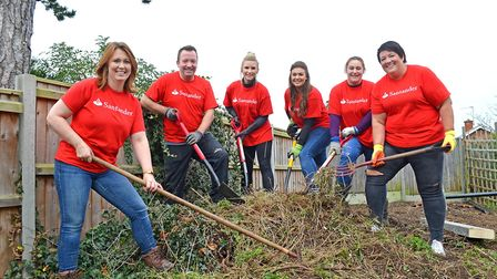 Santander bank employees from the Lowestoft branch help 2nd Carlton Colville Scouts. Pictures: Mick