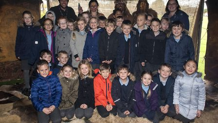 Youngsters from Worlingham Primary school take part in a prehistoric workshop run by the Will Lord c