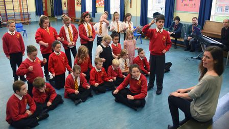 Children at Valley Primary School rehearse their opera, The Barber of Seville, with opera practition