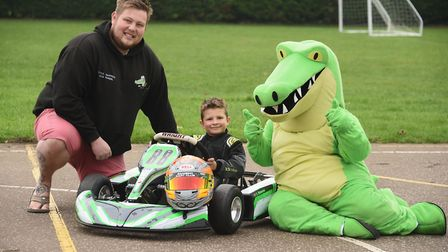 Karting enthusiast, six-year-old Logan Howes with his sponsor, Mike Masters, owner of Little Snapper