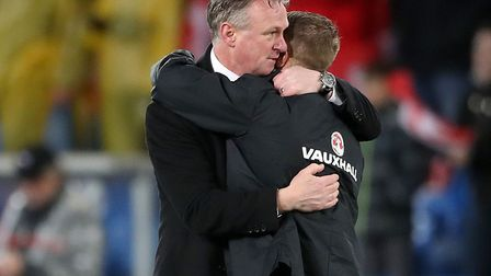 Northern Ireland manager Michael O'Neill embraces Jamie Ward after his side's heartbreaking World Cu