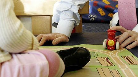 The budget for Norfolk's children's centres could be halved. Pic: Press Association.