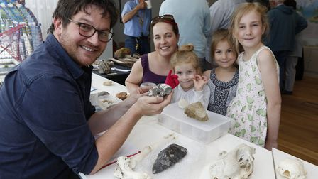 with Ben Garrod identifying fossil brought in by the public at last year's Cley Calling. Pictured ar