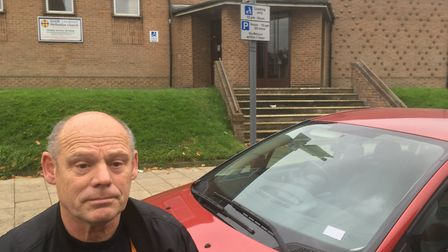 Carpet Shop owner Ron Smith with the offending car on Carlton Road. Picture: David Hannant