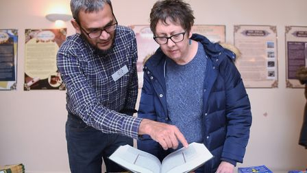 Gail Harris, deputy leader of the City Council, takes a look at the Quran with Surajul Islam at the