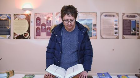Gail Harris, deputy leader of the City Council, takes a look at the Quran at the Islamic Centre Mosq