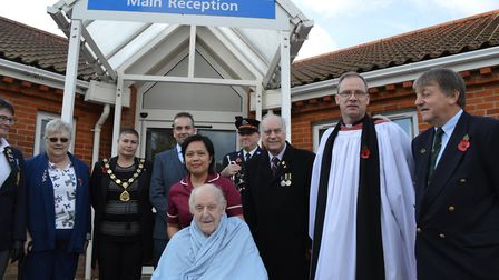 Army veteran Stanley Puddifoot, 100, centre, was among those marking Armistice Day at North Walsham