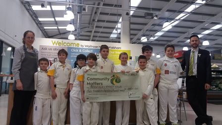 Bradfield Cricket Club collecting its cheque from the Community Matters fundraising event earlier th