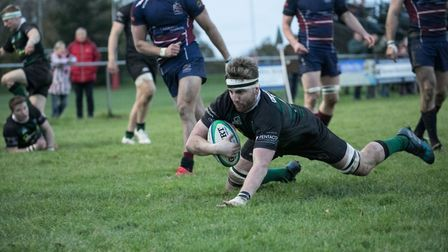 Roydon Miller touches down for North Walsham to help his side to a hard-fought win. Picture: Hywel J