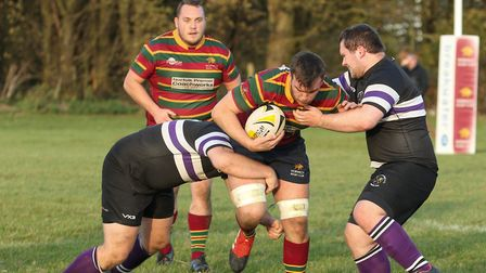 The impressive Laurence Austin in the thick of the action for Norwich against Romford & Gidea Park.