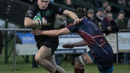 Dan Smith in full flight for North Walsham during their hard-fought win at Scottow. Picture: Hywel J