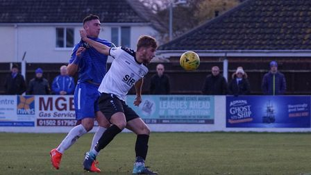 Travis Cole - who was later sent off - tangles with an opponent. Picture: Shirley D Whitlow