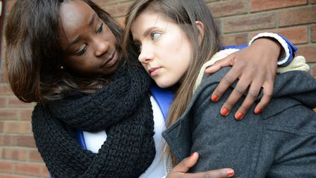 Mental health. Pictured: A young woman suffering from depression is consoled by her friend. Picture: