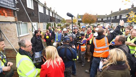 Scores of tradesmen turned up to help the team. Picture: GREGG BROWN