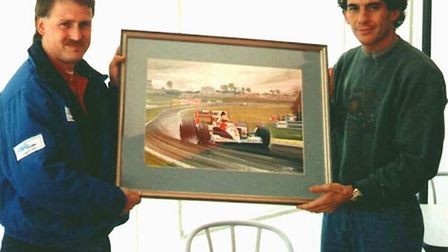 Andrew Kitson with a painting he created for former Formula One driver Ayrton Senna in 1991. Picture
