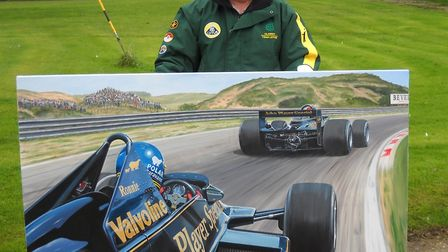 Andrew Kitson with his painting for Classic Team Lotus at Hethel. Picture: Andrew Kitson