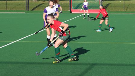 Norwich Dragons goalscorer Olivia Thomas in the thick of the action with joint player-of-the-match L