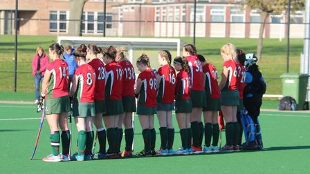Norwich Dragons Ladies pay their respects on Remembrance Weekend. Picture: Club