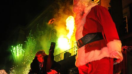 Helen McDermott and Santa dance as the Norwich Christmas lights come on with fireworks. Picture: DEN
