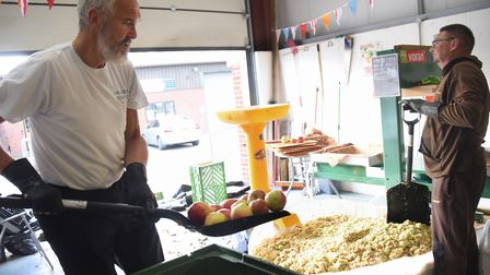 Apple pressing at the Harleston Cider Company, based at Palgrave. Ken Woolley loads the apples into