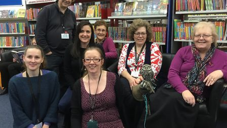 King's Lynn Library staff with Biggles the owl, who joined a talk by the Raptor Trust as part of the