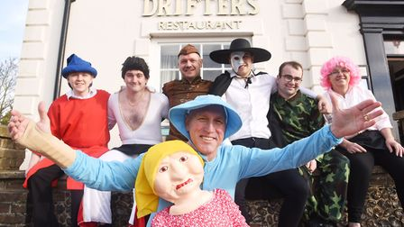 Staff at Drifters in Fakenham, have dressed up for Children in Need. Pictured at the front is Jonath