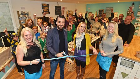 NCFC player Russell Martin cutting the ribbon to mark the opening of Improve Interiors and Mamma Mak