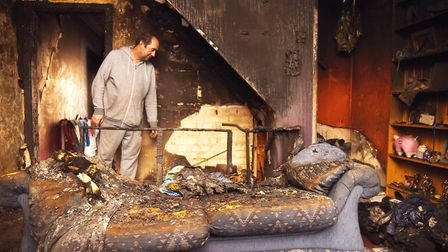 Graham Withers inside his fire damaged home in North Lynn. Picture: Ian Burt