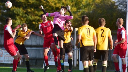 Fakenham Town battled well before going down 2-0 at leaders Felixstowe & Walton. Picture: Nick Butc