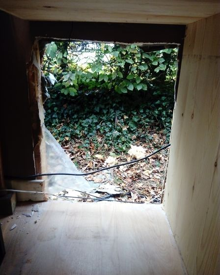 The hole in the wall cut by thieves who stole a safe from Fairhaven Woodland and Water Garden on Hal