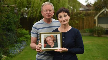 Christine Welfare, sister of Neil Jewell, pictured with her husband Eddie and a picture of Neil. Pic