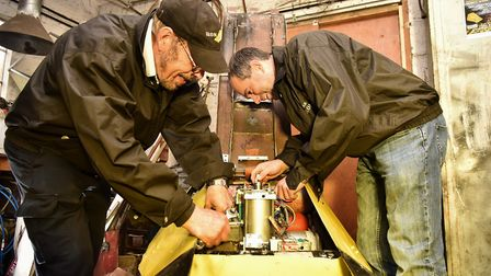Father and son team, Gilbert and Robert Grimm from Bungay with their Robot Wars robot. Byline: Sonya